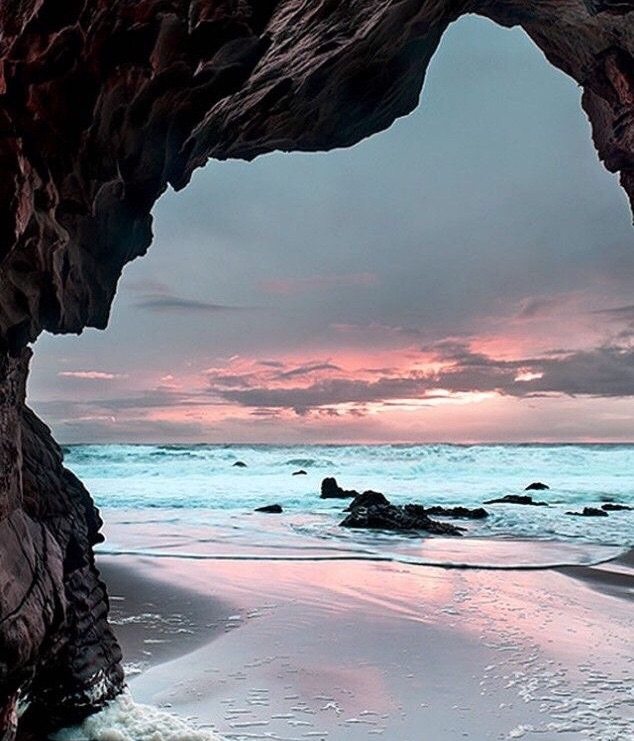 ocean, sky and cave