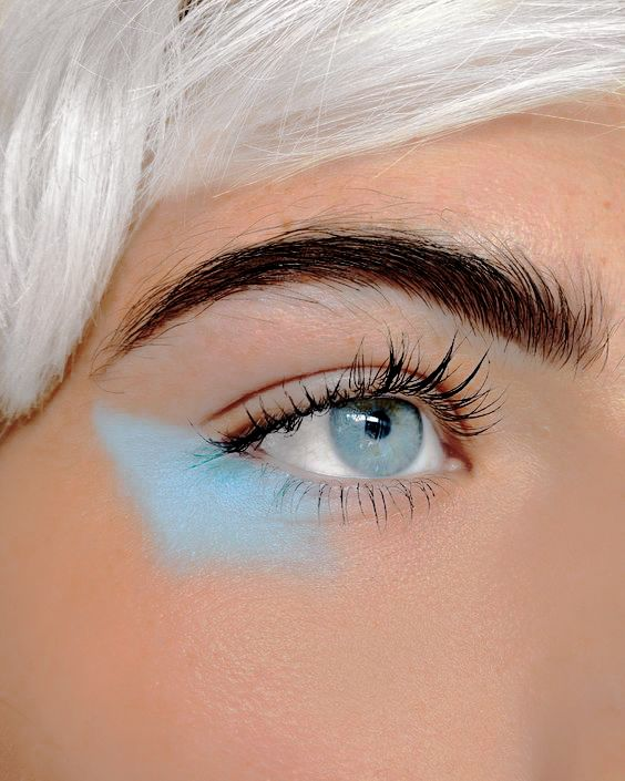 blue, dark brows and blue eyes