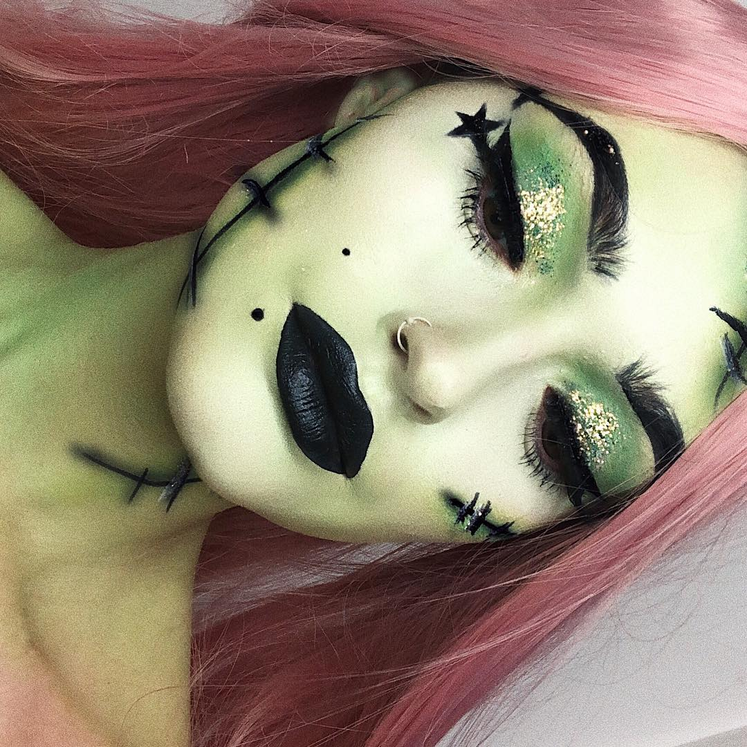 witch makeup, pink hair, green glitter and black lipstick