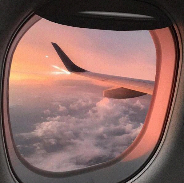 airplane window view sunset